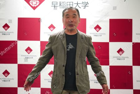 Japanese novelist Haruki Murakami poses for photographers during a press conference at Waseda University in Tokyo