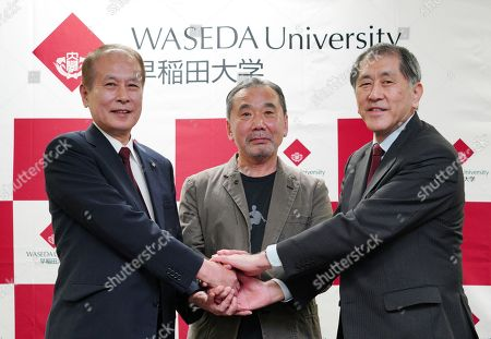 Haruki Murakami, Kaoru Kamata, Aiji Tanaka. Japanese novelist Haruki Murakami, center, poses for photographers with Kaoru Kamata, left, outgoing president of Waseda University, and incoming president Aiji Tanaka, right, during a press conference at Waseda University in Tokyo