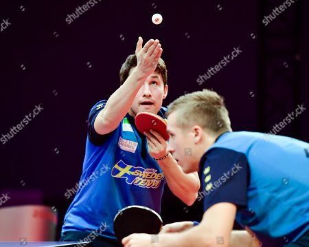 Sweden's Kristian Karlsson (L) and Mattias Falck in action against Liao Cheng-Ting and Lin Yun-Ju of Taiwan during the men's double final table tennis match at the Swedish Open Championships in Stockholm, Sweden, 04 November 2018.