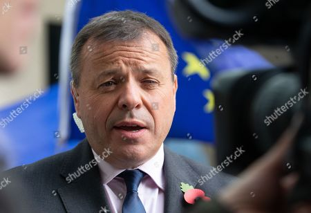 Contraversial businessman, Arron Banks, leaves the BBC studios after appearing on 'The Andrew Marr Show'.  It is claimed that he may have misled Parliament over links between his pro-Brexit campaign and his insurance business during the EU referendum. Hundreds of internal emails leaked by former employees from Eldon Insurance and Rock services reveal that Insurance staff worked on the Leave EU campaign from their company offices. He denies these claims.