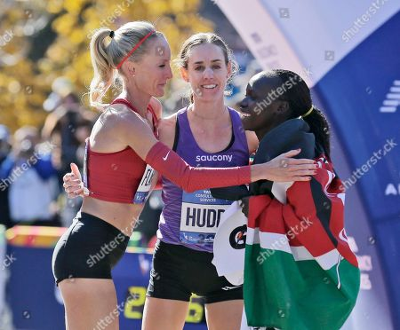 Mary Keitany, Shalane Flanagan, Molly Huddle. First place finisher Mary Keitany of Kenya, right, greets American runners Shalane Flanagan, left, and Molly Huddle at the finish line of the New York City Marathon in New York