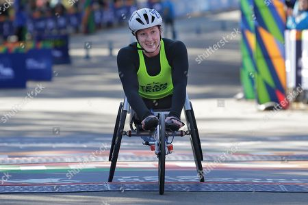 Tatyana McFadden of the United States crosses the finish line second in the women's wheelchair division of the New York City Marathon in New York