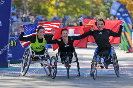 Manuela Schär, Tatyana McFadden, Lihong Zou. Second place finisher Tatyana McFadden of the United States, left, first place finisher Manuela Schär of Switzerland, center, and third place finisher Lihong Zou pose for a picture at the finish line of the New York City Marathon in New York