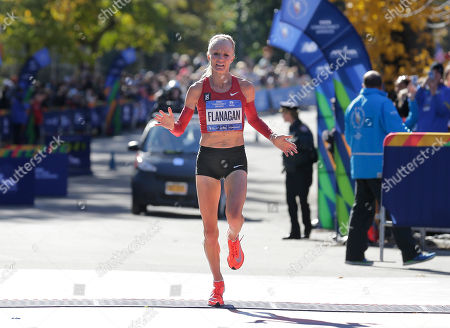 Shalane Flanagan, of the United States, crosses the finish line third in the women's division of the New York City Marathon in New York