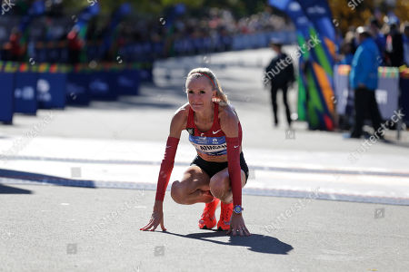 Shalane Flanagan of the United States reacts after crossing the finish line third in the women's division of the New York City Marathon in New York