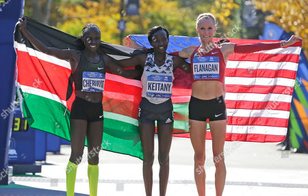 Stock Picture of Mary Keitany, Vivian Cheruiyot, Shalane Flanagan. Second place finisher Vivian Cheruiyot of Kenya, left, first place finisher Mary Keitany of Kenya, center, and third place finisher Shalane Flanagan of the United States pose for a picture at the finish line of the New York City Marathon in New York