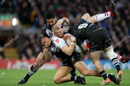 Luke Thompson of England is tackled by Isaac Liu, James Fisher-Harris and Brandon Smith of New Zealand