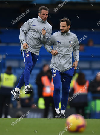 Chelsea Assistant First Team Coach Gianfranco Zola jumps onto the back of Carlo Cudicini