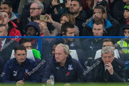 Stock Photo of Dave Reddington, First Team Coach of Crystal Palace FC , Ray Lewington, Assistant Manager of Crystal Palace FC & Roy Hodgson, Manager of Crystal Palace FC during the Premier League match between Chelsea and Crystal Palace at Stamford Bridge, London