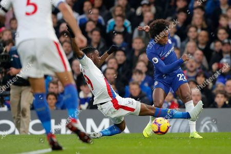 Stock Image of Chelsea's William, right, vies for the ball with Crystal Palace's Aaron Wan-Bissaka during the English Premier League soccer match between Chelsea and Crystal Palace at Stamford Bridge stadium in London