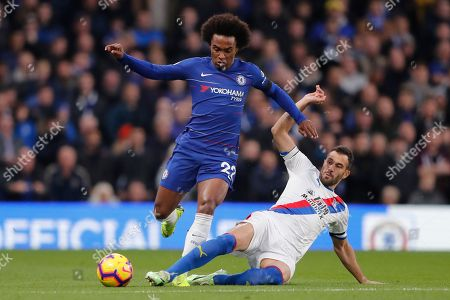 Stock Picture of Chelsea's William, left, vies for the ball with Crystal Palace's Luka Milivojevic during the English Premier League soccer match between Chelsea and Crystal Palace at Stamford Bridge stadium in London