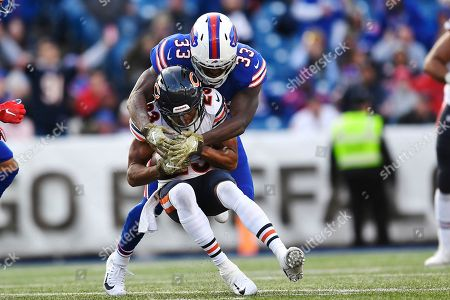 Buffalo Bills' Chris Ivory (33) tackles Chicago Bears' Kyle Fuller (23) after Fuller intercepted a pass during the second half of an NFL football game, in Orchard Park, N.Y