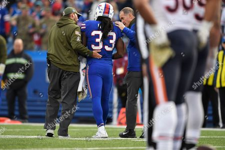 Buffalo Bills running back Chris Ivory (33) is helped off the field during the second half of an NFL football game against the Chicago Bears, in Orchard Park, N.Y