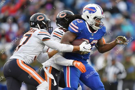 Buffalo Bills running back Chris Ivory (33) rushes during the second half of an NFL football game against the Chicago Bears, in Orchard Park, N.Y