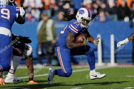 Buffalo Bills running back Chris Ivory (33) rushes during the first half of an NFL football game against the Chicago Bears, in Orchard Park, N.Y