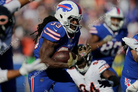 Buffalo Bills' Chris Ivory (33) rushes during the first half of an NFL football game against the Chicago Bears, in Orchard Park, N.Y