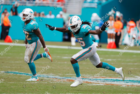 Walt Aikens, Raekwon McMillan. Miami Dolphins defensive back Walt Aikens (35) and Miami Dolphins middle linebacker Raekwon McMillan (52) celebrate after the New York Jets missed a field goal, during the second half of an NFL football game, in Miami Gardens, Fla