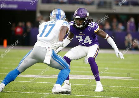 Minnesota Vikings defensive back Holton Hill (24) defends Detroit Lions wide receiver Andy Jones (17) during the first half of an NFL football game, in Minneapolis