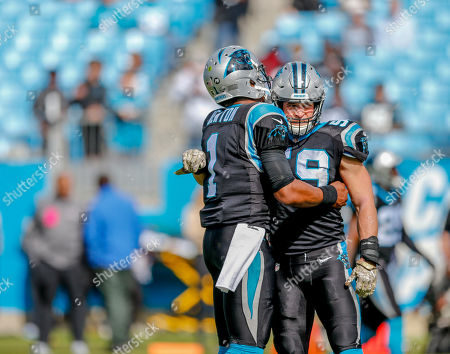 Carolina Panthers quarterback Cam Newton, left, hugs middle linebacker Luke Kuechly before an NFL football game against the Tampa Bay Buccaneers in Charlotte, N.C