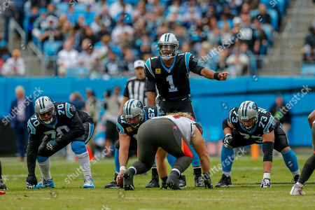 Carolina Panthers quarterback Cam Newton (1) directs his team as offensive guard Trai Turner (70), center Ryan Kalil (67) and offensive guard Greg Van Roten (73) line up against the Tampa Bay Buccaneers an NFL football game in Charlotte, N.C