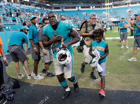 Miami Dolphins running back Frank Gore (21) leaves the field at then end of an an NFL football game against the New York Jets, in Miami Gardens, Fla. The Dolphins defeated the Jets 13-6. Gore past Barry Sanders on career yards from scrimmage