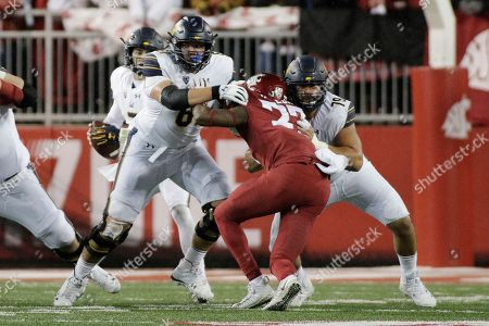 Stock Photo of California offensive lineman Valentino Daltoso, left, and offensive lineman Patrick Mekari (79) block Washington State linebacker Willie Taylor III (27) during the second half of an NCAA college football game in Pullman, Wash