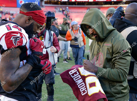 Washington Redskins WR #80 Jamison Crowder signs a jersey for Atlanta Falcons WR #14 Justin Hardy after a NFL football game between the Washington Redskins and the Atlanta Falcons at FedEx Field in Landover, MD