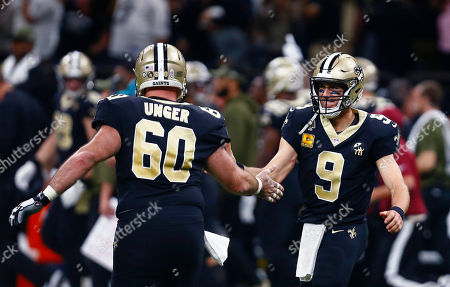 New Orleans Saints quarterback Drew Brees (9) celebrates his 72 yard touchdown pass with center Max Unger (60) in the second half of an NFL football game against the Los Angeles Rams in New Orleans