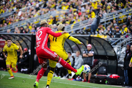 Stock Photo of Columbus Crew SC forward Gyasi Zardes (11) attempts to shield the ball from New York Red Bulls defender Michael Amir Murillo (62) in the first half of the match between New York Red Bulls and Columbus Crew SC in the Conference Semi-finals Leg 1 of 2 at MAPFRE Stadium, in Columbus OH. ..Mandatory Photo Credit: Dorn Byg/Cal Sport Media. ..Columbus Crew SC 0 - New York Red Bulls 0