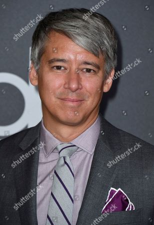 """Tom Cross, winner of the Hollywood editor award for """"First Man,"""" arrives at the Hollywood Film Awards, at the Beverly Hilton Hotel in Beverly Hills, Calif"""