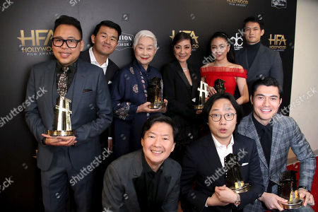 Clockwise: Nico Santos, Ronny Chieng, Lisa Lu, Michelle Yeoh, Constance Wu, Henry Golding, Jimmy O. Yang and Jeong