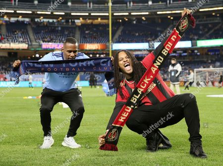 Waka Flocka Flame, right, poses for a photo before an MLS playoff soccer match between New York City FC and Atlanta United, in New York. Atlanta United won 1-0