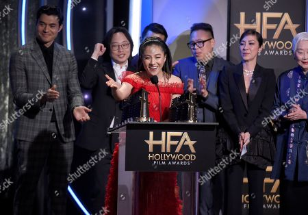 """Constance Wu, Henry Golding, Jimmy O. Yang, Ronny Chieng, Nico Santos, Michelle Yeoh, Lisa Lu. Constance Wu and the cast of """"Crazy Rich Asians"""" accepts the Hollywood breakout ensemble award"""