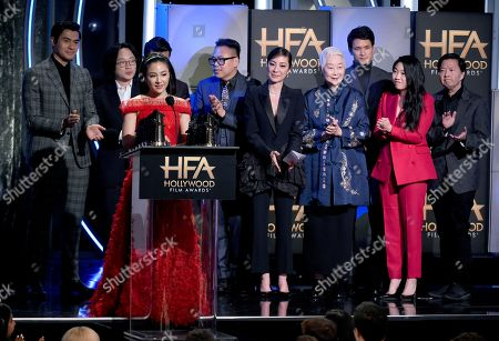 """Constance Wu, Henry Golding, Jimmy O. Yang, Ronny Chieng, Nico Santos, Michelle Yeoh, Lisa Lu, Harry Shum Jr., Awkwafina, Ken Jeong. Constance Wu and the cast of """"Crazy Rich Asians"""" accepts the Hollywood breakout ensemble award"""