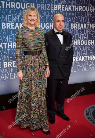 Julia and Yuri Milner arrive at the 7th annual Breakthrough Prize Ceremony at the NASA Ames Research Center on in Mountain View, Calif