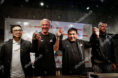 Stock Picture of (L-R) Philippines advertising manager Jun Miras, Philippines national soccer team head coach Sven-Goran Eriksson, team manager Dan Palami and football adviser Scott Cooper join hands during a press conference in Taguig, south of Manila, Philippines, 05 November 2018. Erikkson who had previously managed England in the 2002 and 2006 FIFA World Cup will lead the Philippines as head coach in the 2018 AFF Suzuki Cup later this month and the Asian Cup next year.