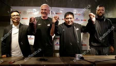 Stock Image of From left; Philippines football advertising manager Jun Miras, Philippines national football team's new head coach Sven-Goran Eriksson, team manager Dan Palami and football adviser Scott Cooper join hands during a press conference in metropolitan Manila, Philippines on . Erikkson, a former England team manager, will be the head coach for the Philippine team in the 2018 AFF Suzuki Cup later this month and the Asian Cup next year