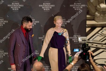 British actress Tilda Swinton (R) arrives with her partner German visual artist Sandro Kopp at the opening of the exhibition 'Spitzmaus Mummy in a Coffin and Other Treasures from the Kunsthistorisches Museum - Wes Anderson and Juman Malouf' at the Museum of Fine Arts (KHM) in Vienna, Austria, 05 November 2018. The Kunsthistorische Museum invited US filmmaker Wes Anderson and his partner Juman Malouf to curate the exhibition. The exhibition runs from 06 November 2018 until 29 April 2019.