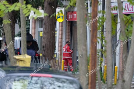 Stock Image of A general view on a post office, where a man took hostages in Reggio Emilia, Italy, 05 November 2018. According to reports, Francesco Amato, the man convicted last week in the sprawling 'Aemilia' trial on 'Ndrangheta mafia infiltration, entered a post office and took hostage five staff members threatening with a knife. One of the five hostages was released after an hour. Police on the site is negotiating with Amato and is considering wether to send in special forces.