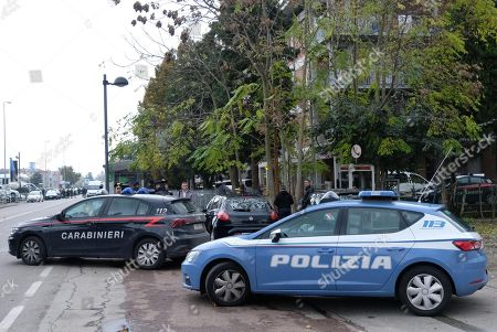 Stock Picture of Police near a post office, where a man took hostages in Reggio Emilia, Italy, 05 November 2018. According to reports, Francesco Amato, the man convicted last week in the sprawling 'Aemilia' trial on 'Ndrangheta mafia infiltration, entered a post office and took hostage five staff members threatening with a knife. One of the five hostages was released after an hour. Police on the site is negotiating with Amato and is considering wether to send in special forces.