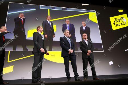 Five time Tour de France winners Eddy Merckx of Belgium (C), Bernard Hinault of France (R) attend the presentation of the Tour de France 2019