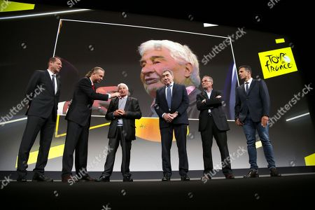 Stock Photo of (From L) General Director of the Tour de France Christian Prudhomme, French cyclism legend Raymond Poulidor, five-time Tour de France winner, Belgium's Eddy Merckx, five-time Tour de France winner, France's Bernard Hinault and five consecutive Tours de France winner, Spain's Miguel Indurain attend the presentation of the official route of the 2019 edition of the Tour de France