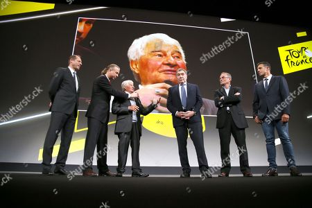 (From L) General Director of the Tour de France Christian Prudhomme, French cyclism legend Raymond Poulidor, five-time Tour de France winner, Belgium's Eddy Merckx, five-time Tour de France winner, France's Bernard Hinault and five consecutive Tours de France winner, Spain's Miguel Indurain attend the presentation of the official route of the 2019 edition of the Tour de France