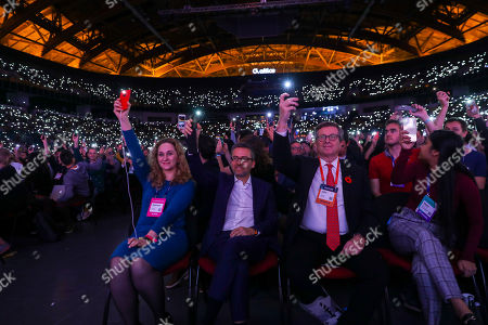 Carlos Moedas (C-L), the European Comissioner for Research, Science and Innovation, attends the night's proceedings on the the first day of the Web Summit in Lisbon, 05th november 2018.