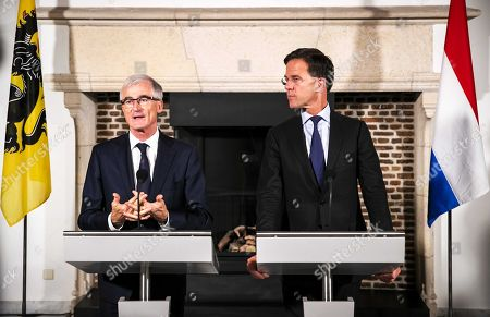 Dutch Prime Minister Mark Rutte (R) talks to the press together with Flemish Prime Minister Geert Bourgeois at the start of a Flemish-Dutch Strategic Summit in Middelburg, Zeeland, The Netherlands, 05 November 2018. During the summit government members from both countries will discuss once again concrete cooperation dossiers on strategic level.