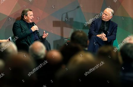 Former German Chancellor Gerhard Schroeder (L) and member of the Green Party, Juergen Trittin (R), take part in an event on the 20th anniversary of the election of Schroeder as German Chancellor, in Berlin, Germany, 05 November 2018. He served as Chancellor from 1998 to 2005, leading a coalition government of the SPD and the Greens.