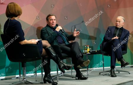Stock Photo of Former German Chancellor Gerhard Schroeder (C) and member of the Green Party, Juergen Trittin (R), take part in an event on the 20th anniversary of the election of Schroeder as German Chancellor, in Berlin, Germany, 05 November 2018. He served as Chancellor from 1998 to 2005, leading a coalition government of the SPD and the Greens.