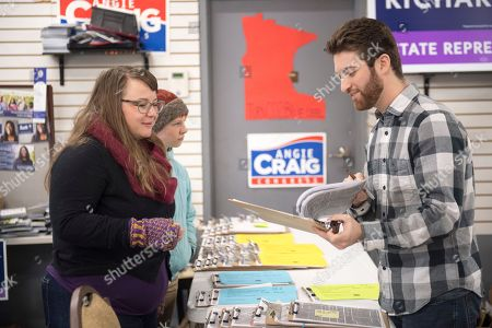 Alexis Lohse (L) of St. Paul gets campaign materials from campaign staffer Nick Cohen (R), as they get ready to door knock for Democrat Angie Craig, who is campaigning for US House district 2, in South St Paul, Minnesota, USA, 05 November 2018. Angie Craig is challenging incumbent Republican US Rep. Jason Lewis in the 06 November midterm election.