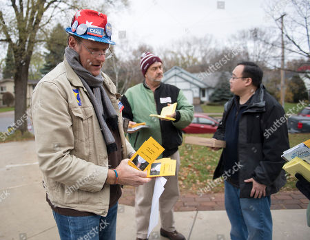 Marcus Faseo (L), Rick Hansen (C) and Peter Stromeier (R) get ready to door knock for Democrat Angie Craig, who is campaigning for US House district 2, in South St Paul, Minnesota, USA, 05 November 2018. Angie Craig is challenging incumbent Republican US Rep. Jason Lewis in the 06 November midterm election.