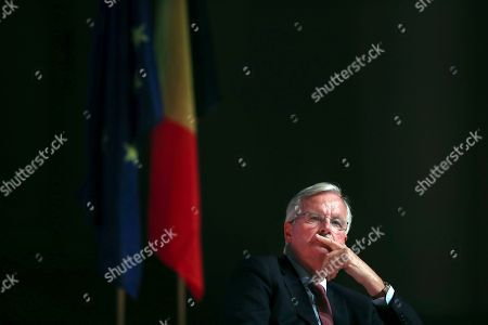 European Union chief Brexit negotiator Michel Barnier listens to former European Council President Herman Van Rompuy before delivering a speech during a conference at Bozar music centre in Brussels